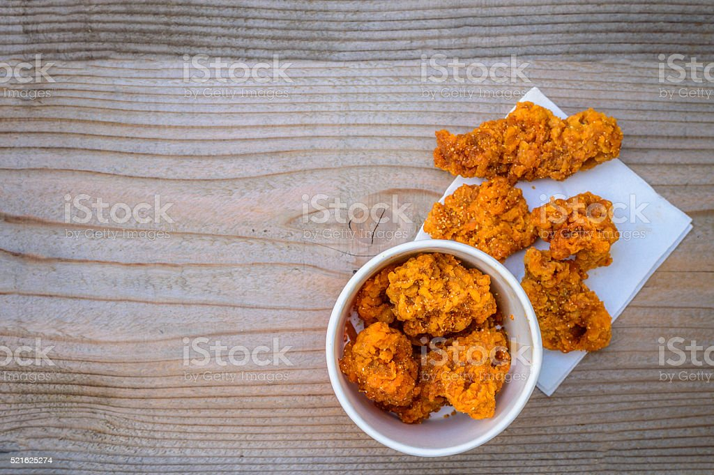 Fried chicken on a wooden floor. stock photo