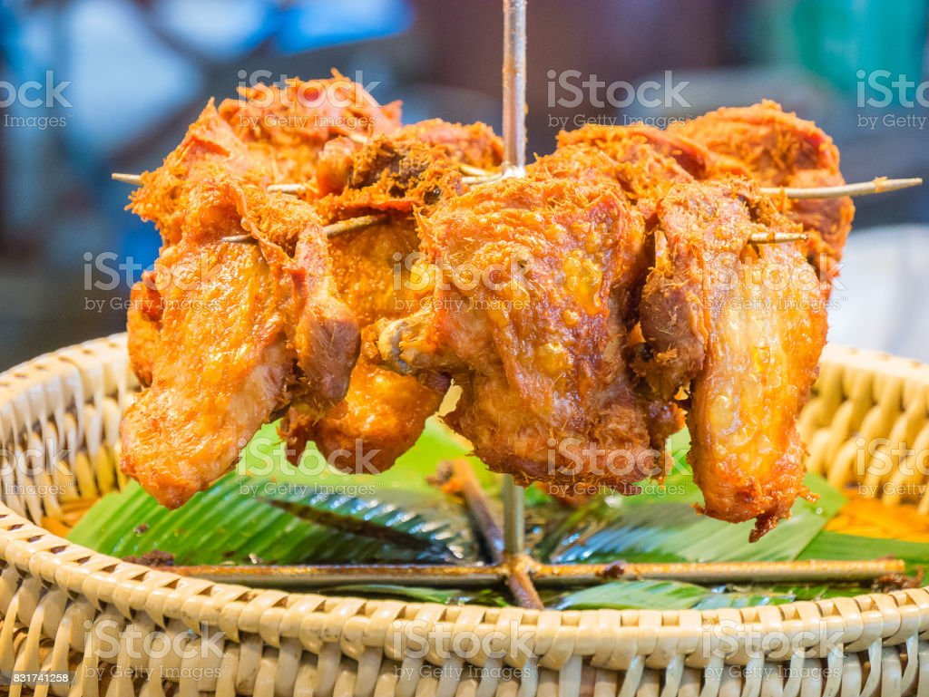 Fried chicken on banana leaves stock photo