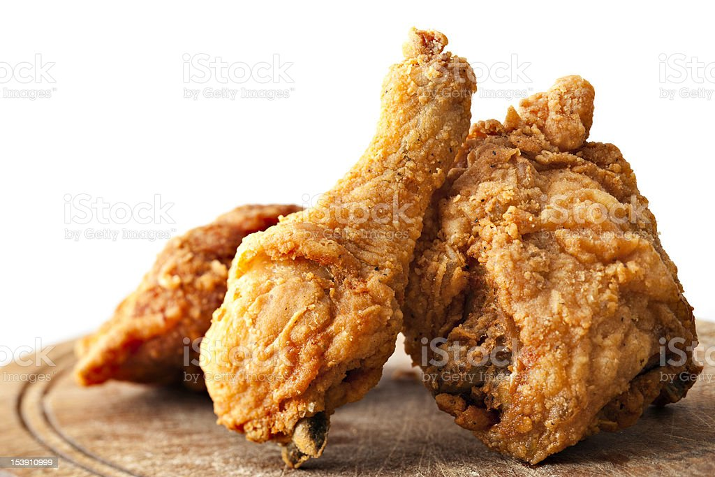 Fried chicken on cutting board stock photo