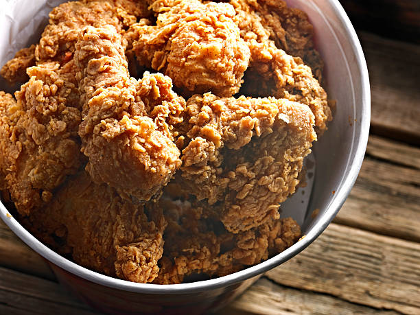 Fried Chicken Fried Chicken in a bucket. fried chicken stock pictures, royalty-free photos & images