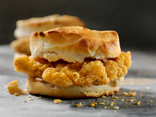 Fried Chicken Sandwich  on a Biscuit Fried Chicken Sandwich  on a Biscuit biscuit stock pictures, royalty-free photos & images