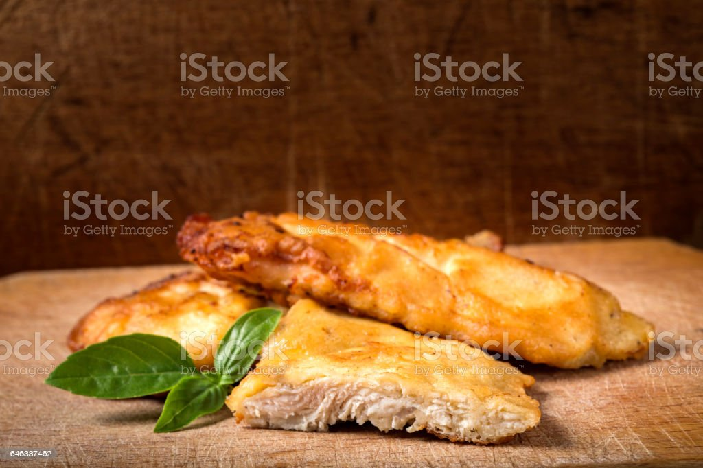 Fried chicken schnitzel with basil stock photo