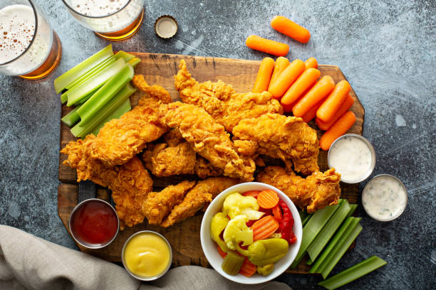 Fried chicken tenders with veggies stock photo