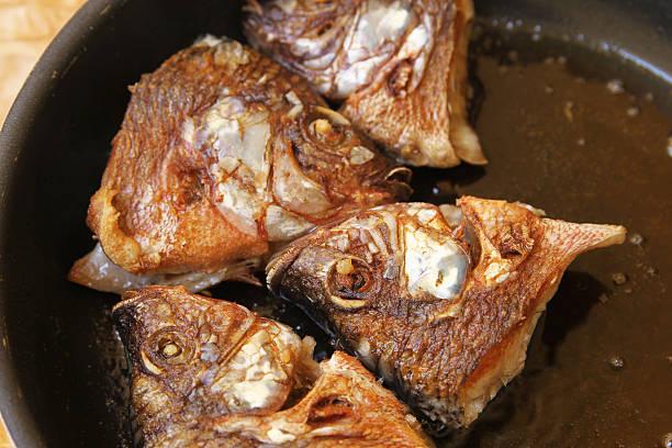 fried cichlid fish stock photo