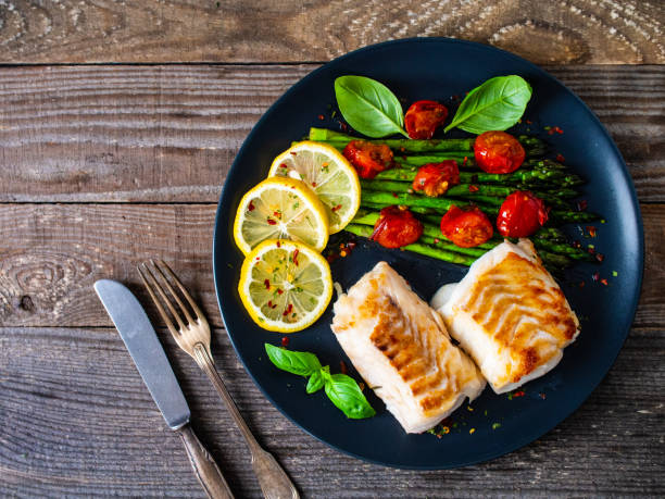 Fried cod fillet with fresh vegetables stock photo