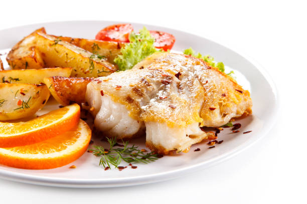 Fried cod fillet with potatoes and vegetables
