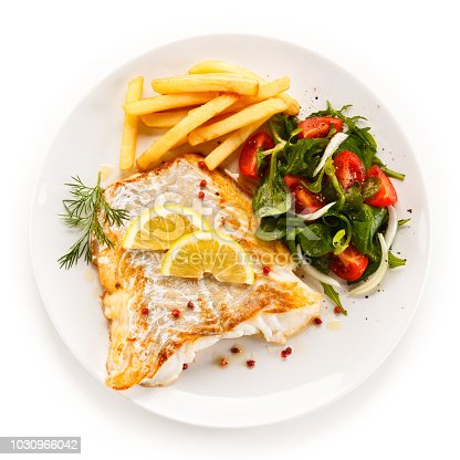 istock Fried cod fillets and fresh vegetables 1030966042