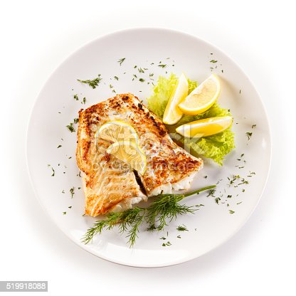 istock Fried cod fillets and vegetables 519918088