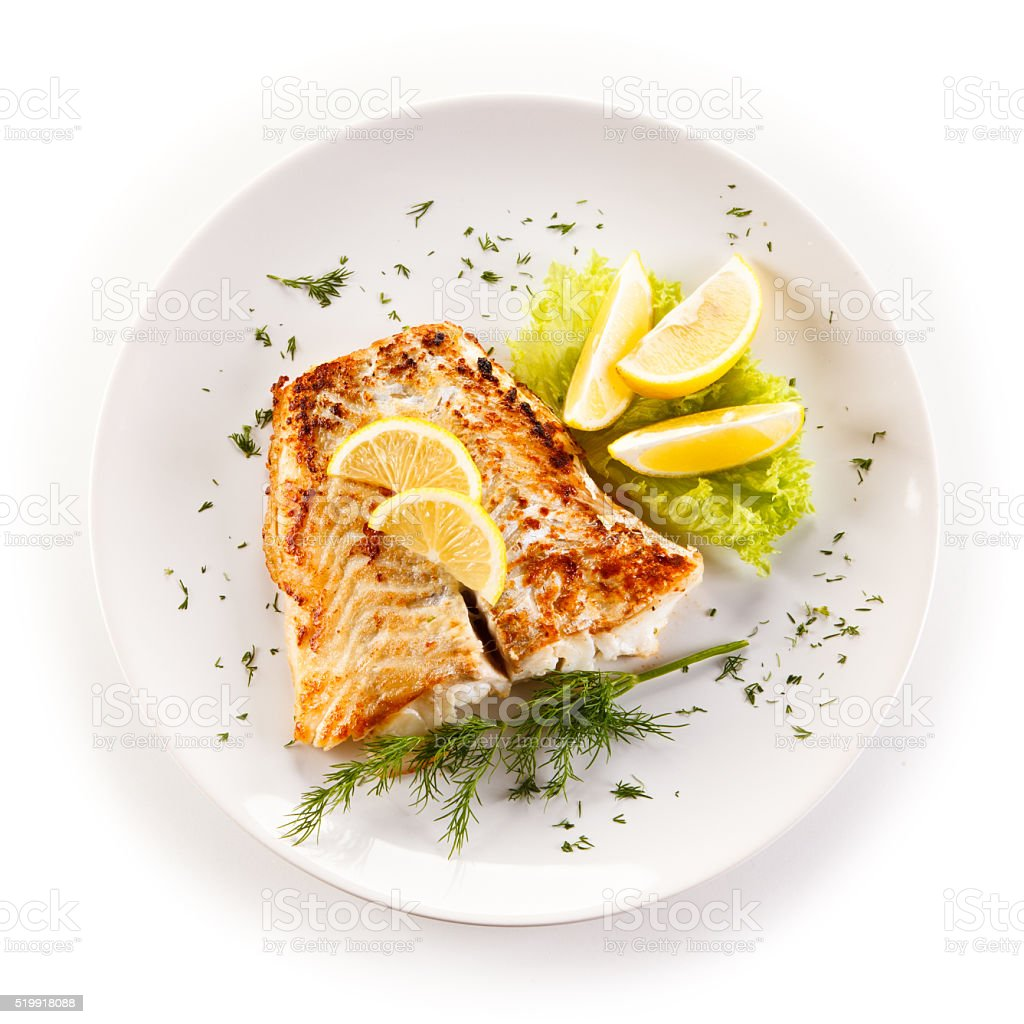 Fried cod fillets and vegetables stock photo