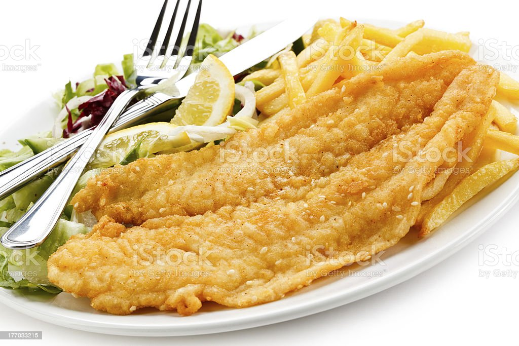 Fried cod, French fries and vegetables royalty-free stock photo