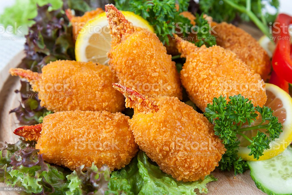 Fried crab claws with cucumber, lemon, lettuce and parsley royalty-free stock photo