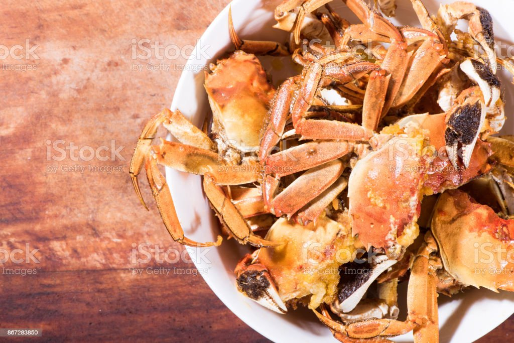 Fried crabs on the wooden table. stock photo