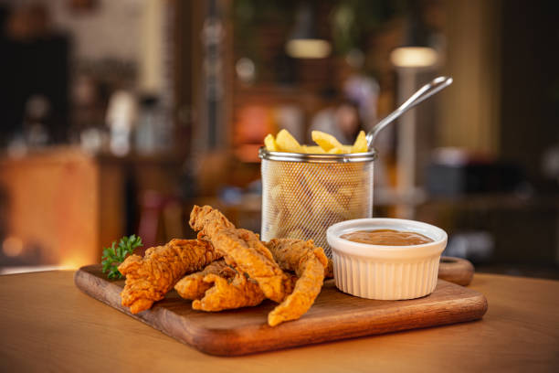 Fried crispy chicken nuggets stock photo