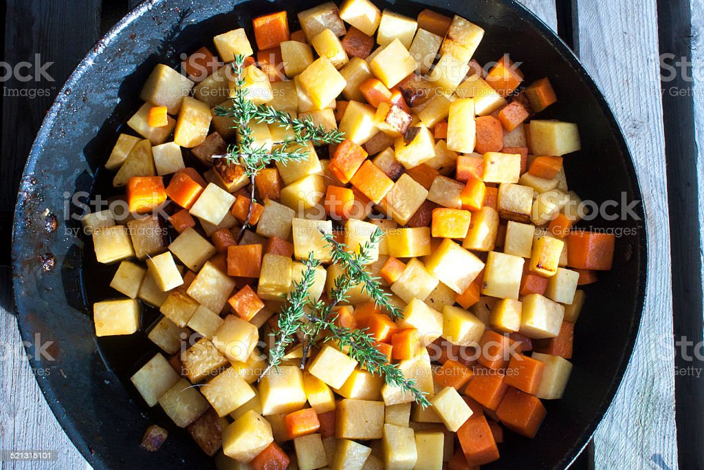 Fried dices of carrot and swede stock photo