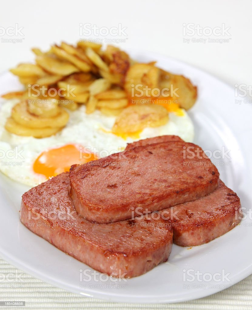 Fried Egg and canned meat product stock photo