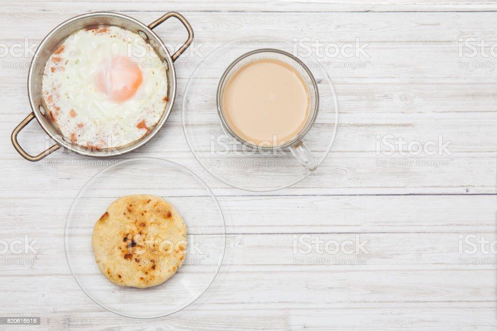 Fried egg, coffee and arepa stock photo