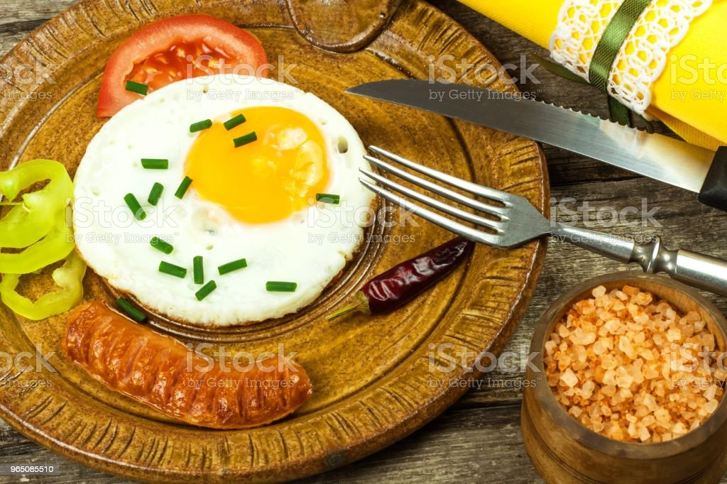 Fried egg for breakfast. Diet food. Food preparation. Fried egg on a wooden table. royalty-free stock photo