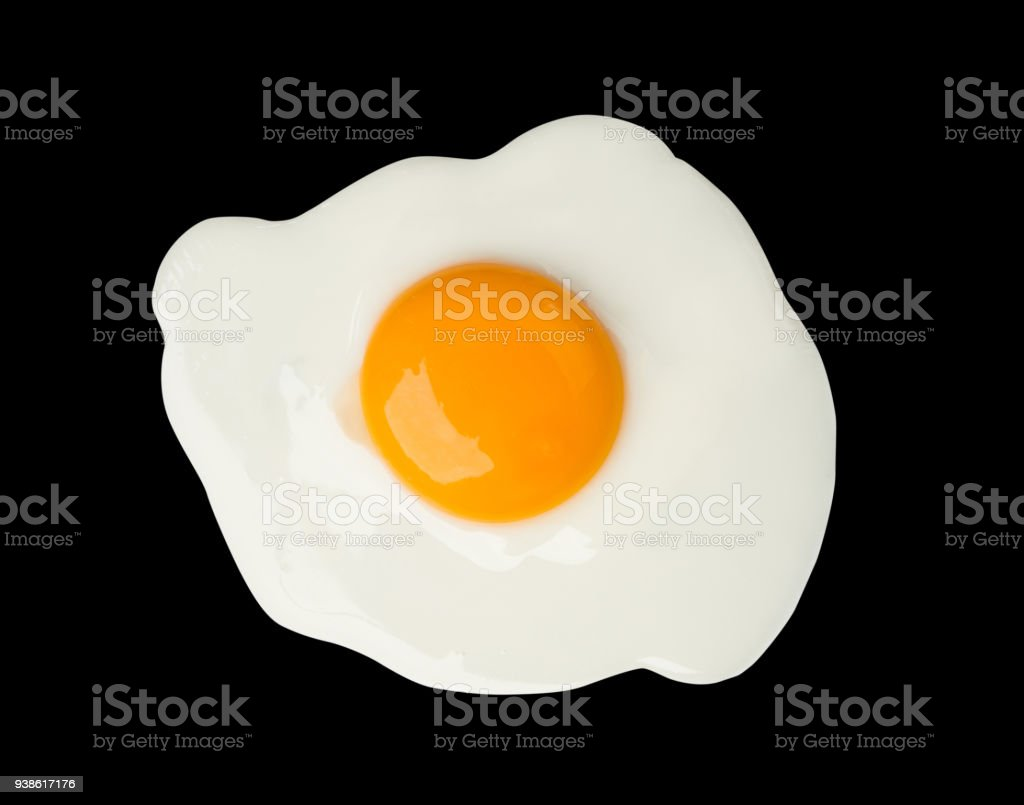 Fried egg isolated on black background food cooking photo object design stock photo