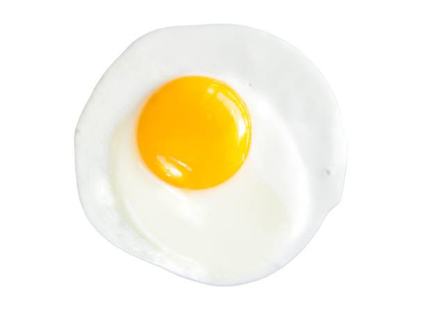 Fried egg isolated on white background Fried egg isolated on white background egg white stock pictures, royalty-free photos & images