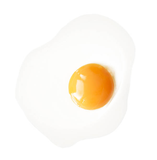 fried egg isolated on white background. - fried egg stock photos and pictures