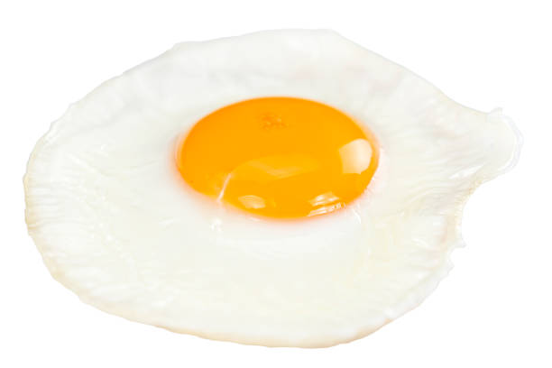 fried egg isolated on white - fried egg stock photos and pictures