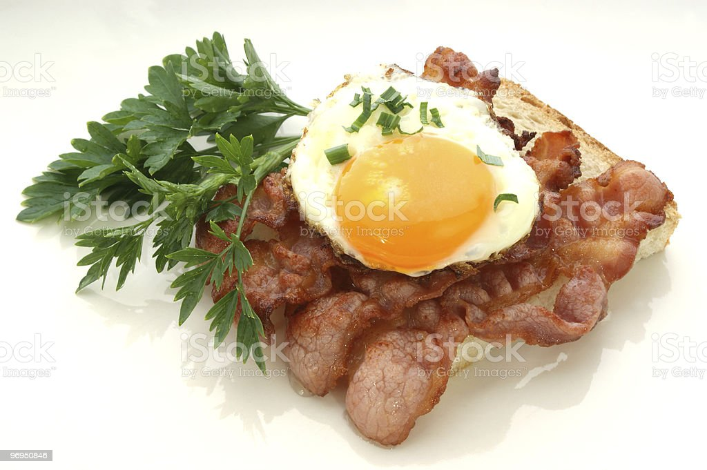 fried egg on grilled bacon royalty-free stock photo