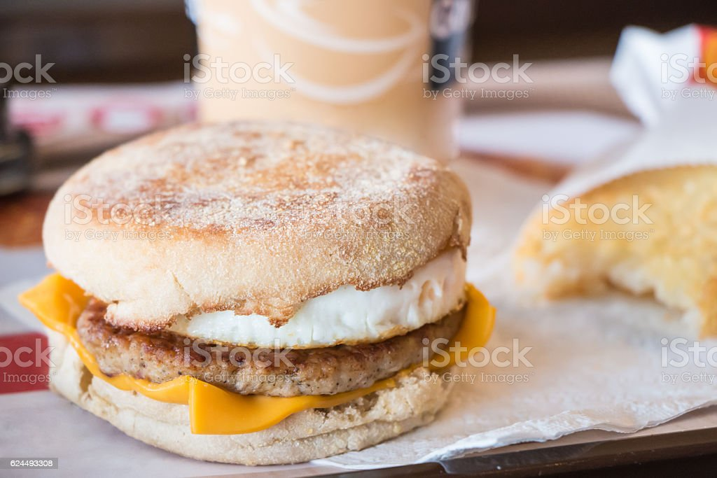 Fried egg on pork with a bagel and cheese stock photo