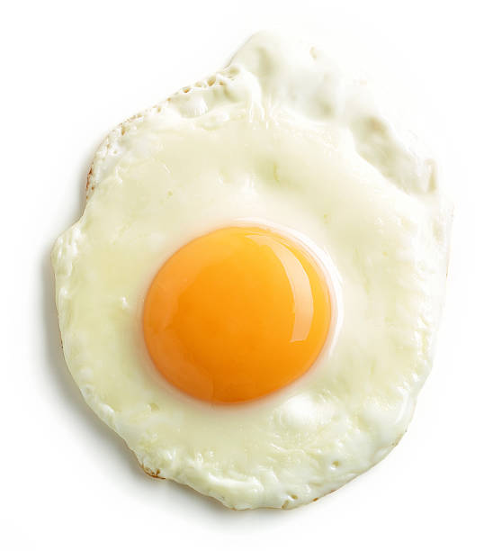 fried egg on white background - fried egg stock photos and pictures