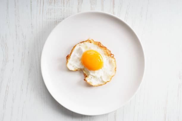 fried egg - fried egg stock photos and pictures