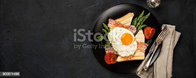 istock Fried egg with bread toast and asparagus 900874496