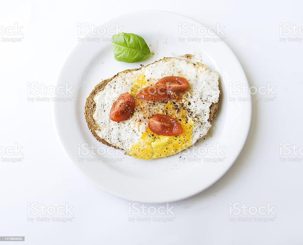 Fried egg with tomatoes and basil royalty-free stock photo