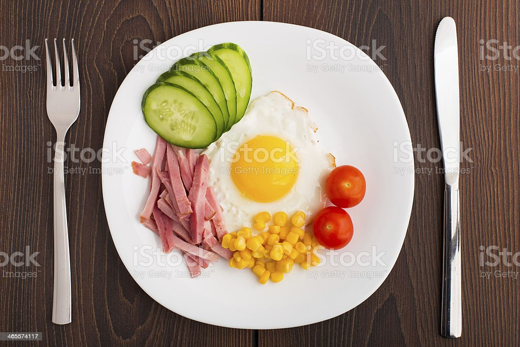 Fried egg with vegetables and ham royalty-free stock photo