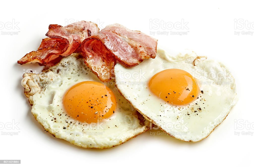 fried eggs and bacon stock photo