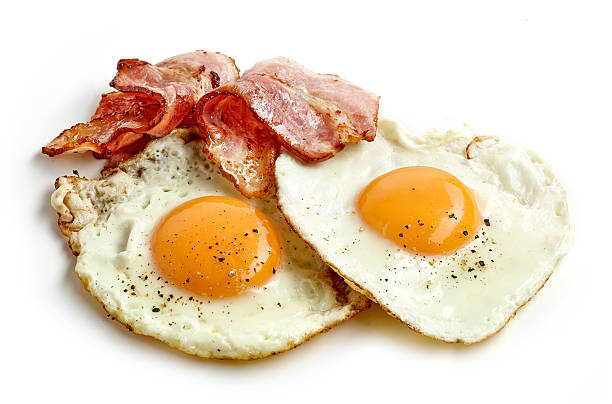 fried eggs and bacon - fried egg stock photos and pictures