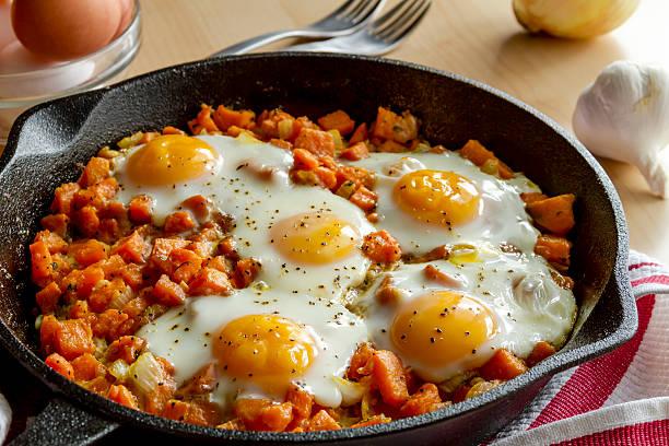 Fried Eggs and Sweet Potato Hash stock photo