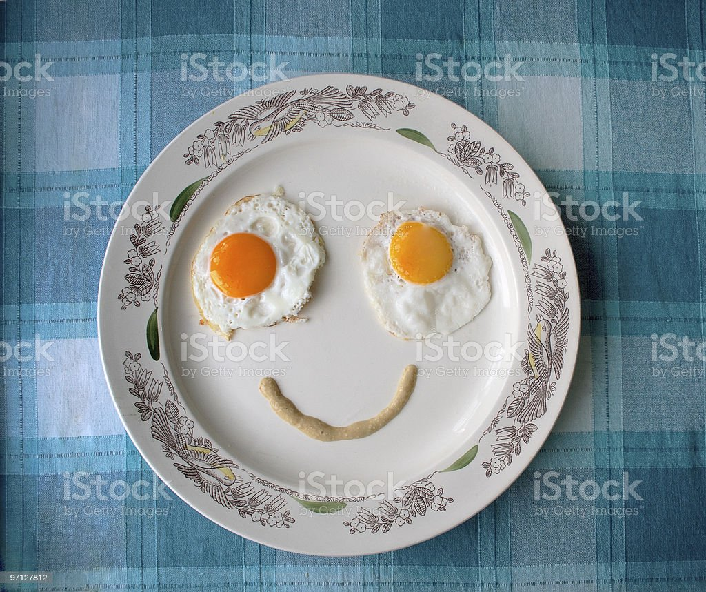 Fried eggs face stock photo