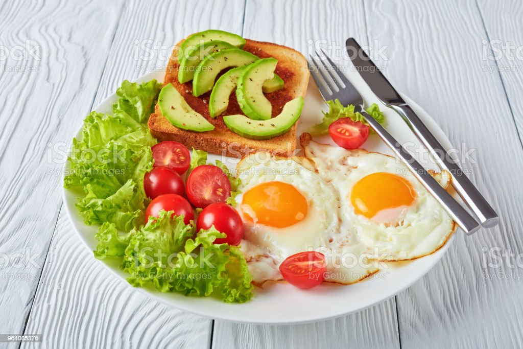 fried eggs, fresh salad, toast. close-up - Royalty-free Above Stock Photo