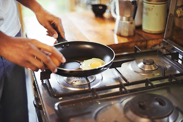 Fried eggs on the menu for breakfast stock photo