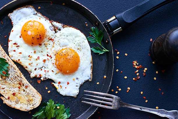 fried eggs - fried egg stock photos and pictures