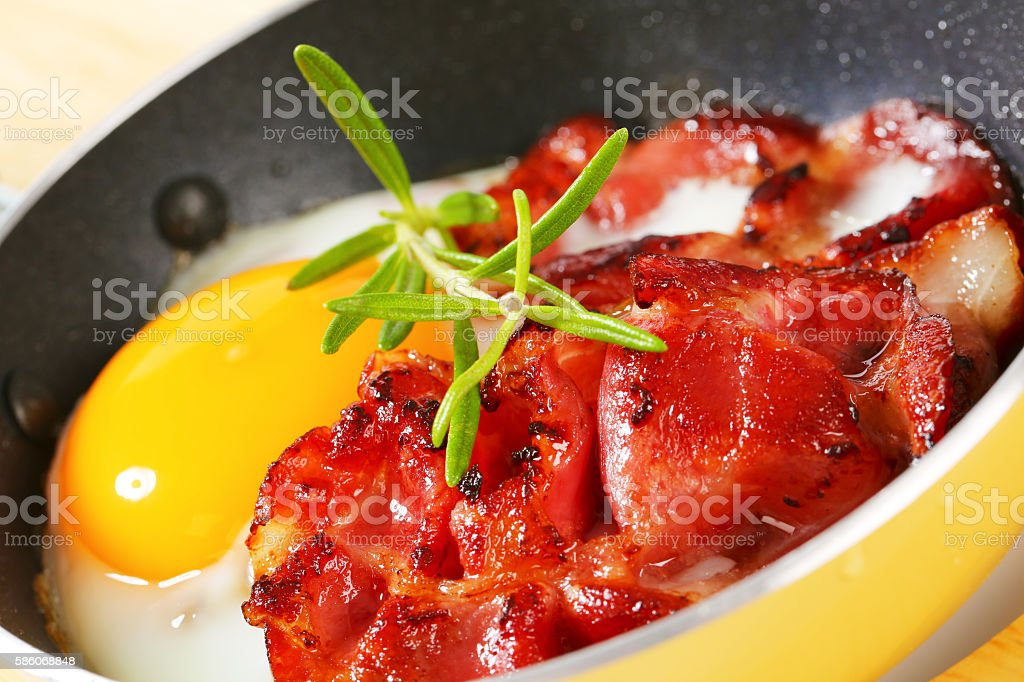 Fried eggs with bacon stock photo