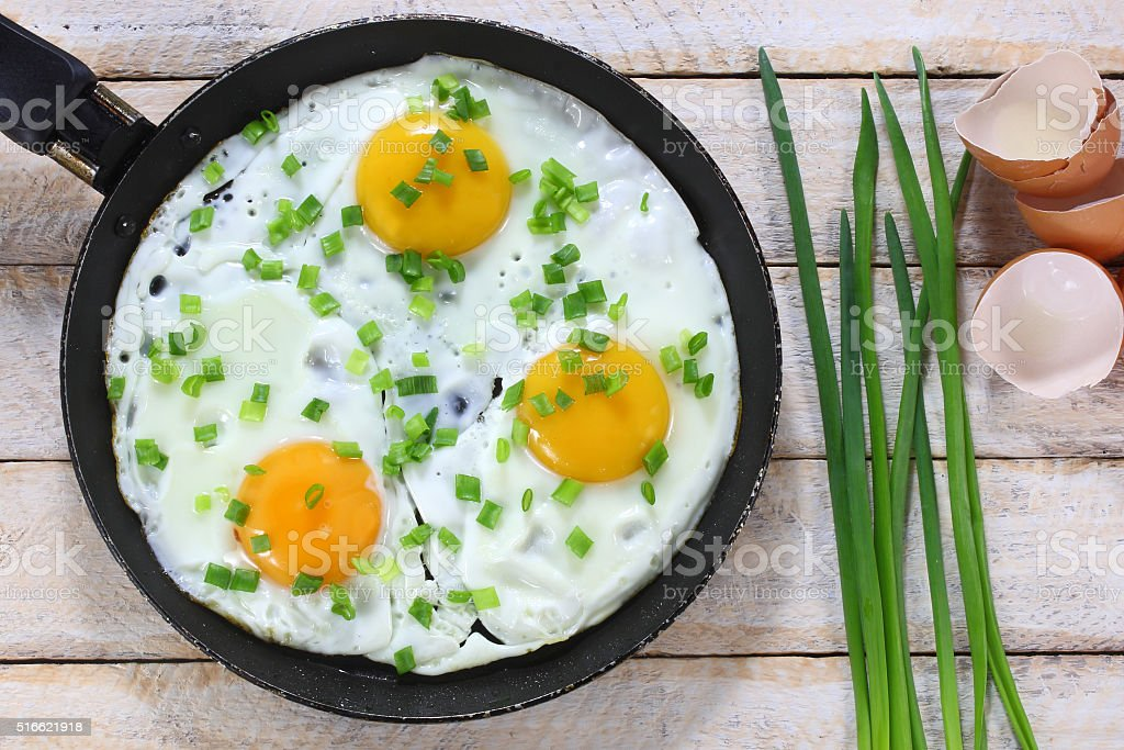 Fried eggs with chives stock photo