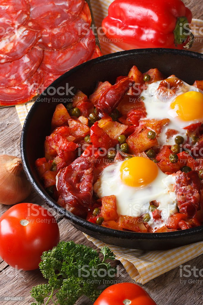 Fried eggs with chorizo and vegetables on the Flemish recipe stock photo