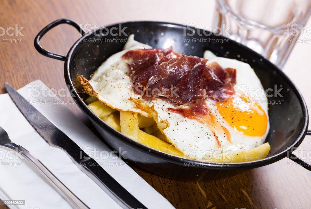 Fried eggs with Jabugo ham stock photo