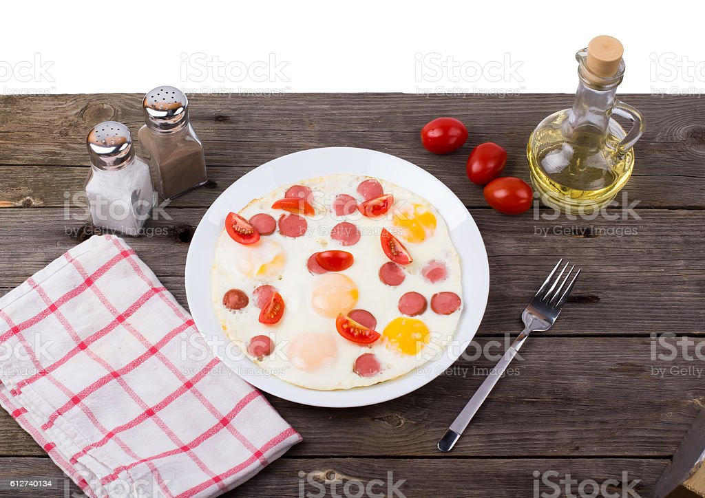 Fried eggs with sausage slices stock photo