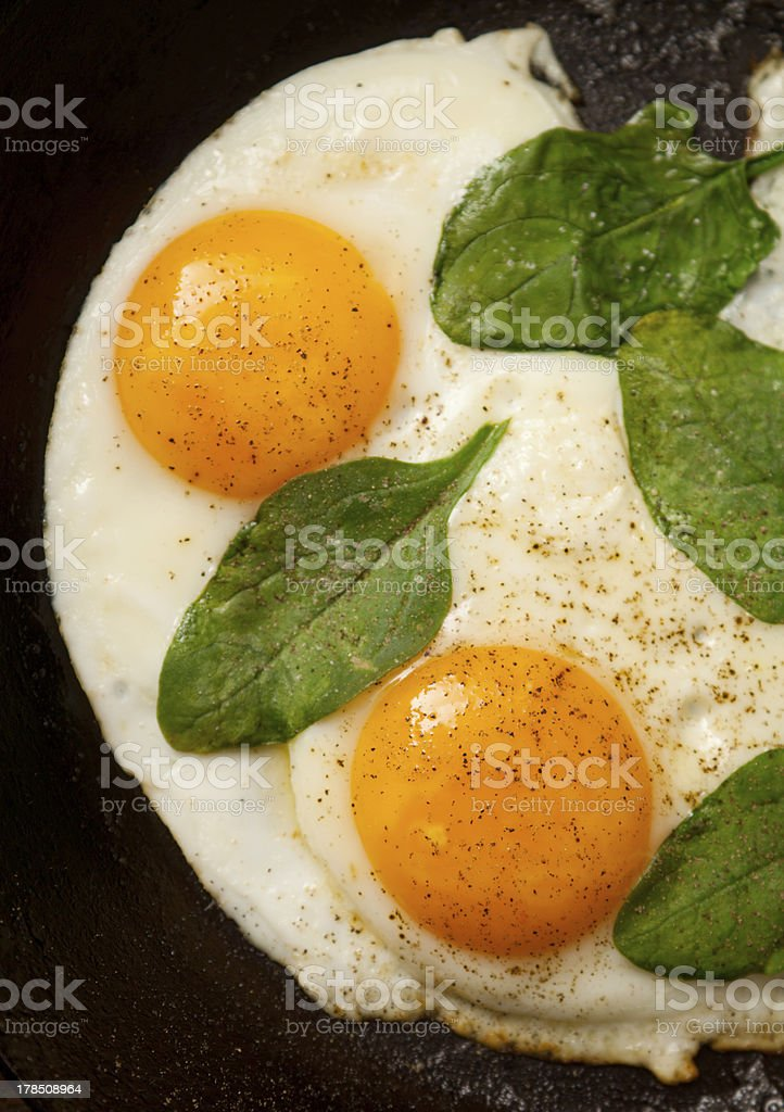 Fried eggs with spinach royalty-free stock photo
