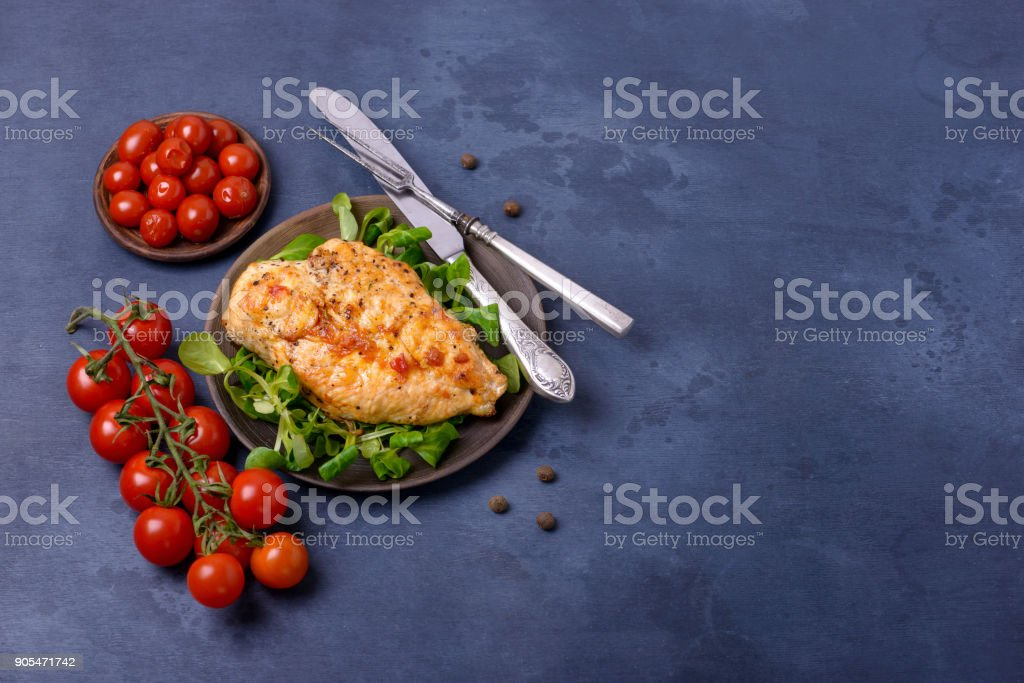 Fried fillet chicken and tomatoes stock photo