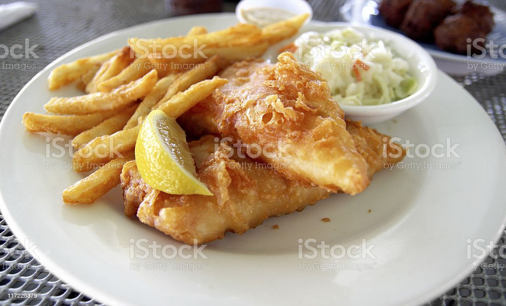 Fried fish and chips on a white plate stock photo