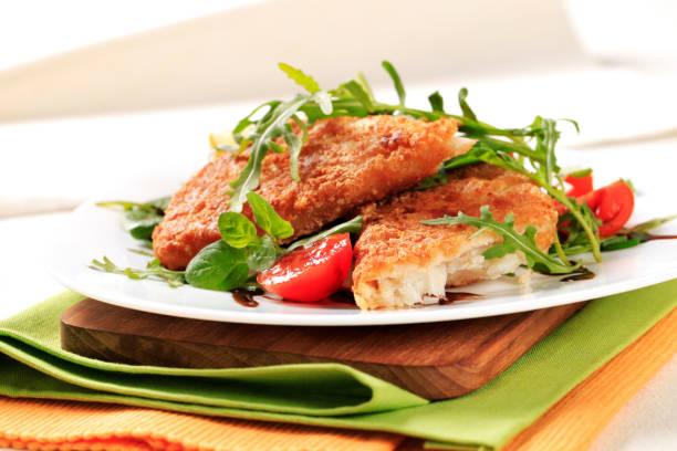Fried fish and fresh salad stock photo