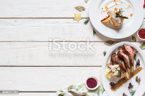 istock Fried fish and meat on white wooden table 646207252