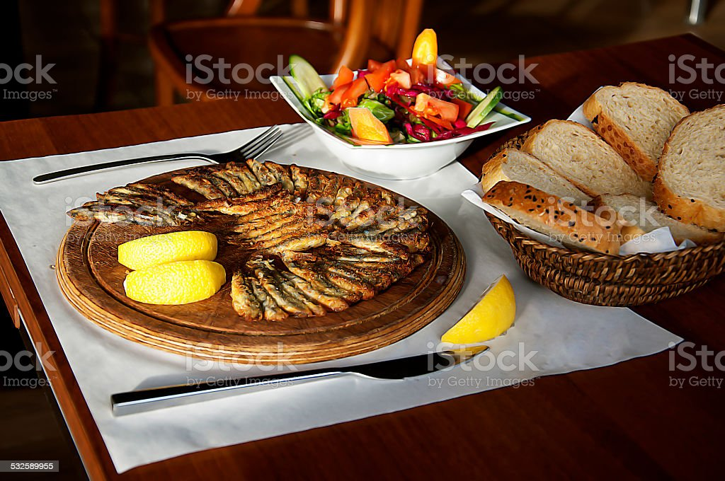 fried  fish and mixed vegetable salad stock photo